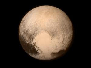 Pluto, with heart-shaped feature, Tombaugh Regio, visible