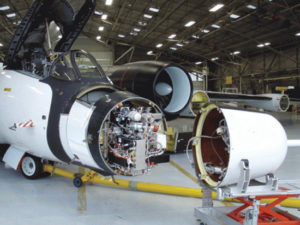 An airplane with the nose open, revealing mass spectrometer inside